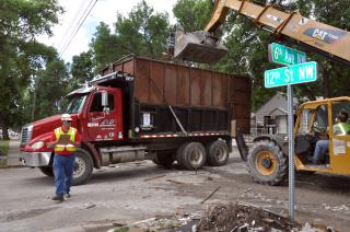 USACE quality assurance inspector monitors debris removal in Minot, ND by Flickr user USACE HQ